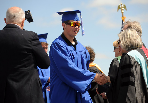 20110528_LHS_GRAD_4.jpg Graduate Douglas Richitson shakes hands after receiving his diploma during commencement Saturday May 28, 2011 at Longmont High School. (Lewis Geyer/Times-Call)