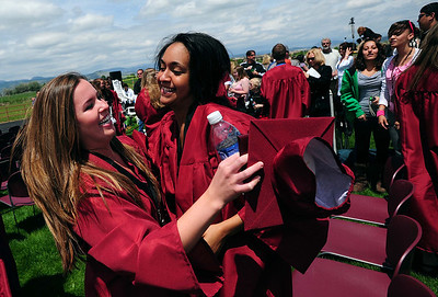 20110528_SCHS_2.jpg Silver Creek graduates Leah Dimambro, left, and Thalia Schetz celebrate after their ceremony Saturday, May 28, 2011. (Joshua Buck/Times-Call)