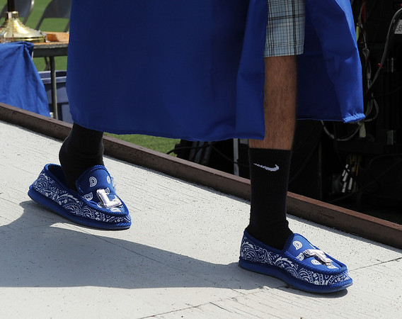 20110528_LHS_GRAD_10.jpg A comfortable pair of slippers are worn during commencement Saturday May 28, 2011 at Longmont High School. (Lewis Geyer/Times-Call)