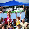 20110528_NHS_6.jpg Brittany Anderson's sisters Tiffany and Stephanie Anderson hold up a banner as their father and Brittany's boyfriend Tyler Hitchcock pin it to their tent at graduation Saturday, May 28, 2011. (Joshua Buck/Times-Call)