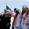 20110528_ERIE_GRAD_6.jpg Assistant principal Doug Kudrna applauds the valedictorians during commencement Saturday May 28, 2011 at Erie High School. (Kimberli Turner/Times-Call)