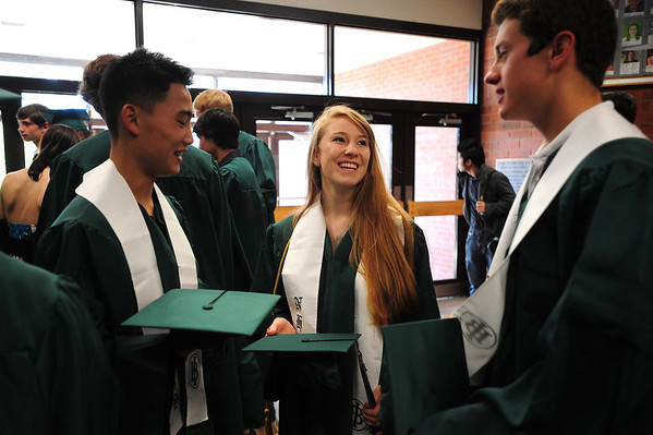 20110528_NHS_2.jpg Niwot graduates, from left, James Hong, Camille Holmes and Ben Rodriguez chat before their commencement ceremony Saturday, May 28, 2011. (Joshua Buck/Times-Call)