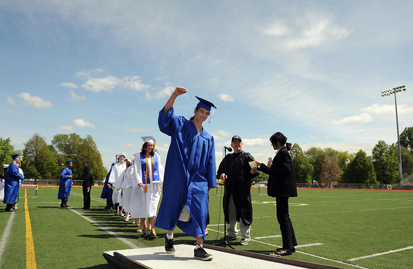 20110528_LHS_GRAD_8.jpg Keifer Johnson walks up the ramp to receive his diploma during commencement Saturday May 28, 2011 at Longmont High School. (Lewis Geyer/Times-Call)