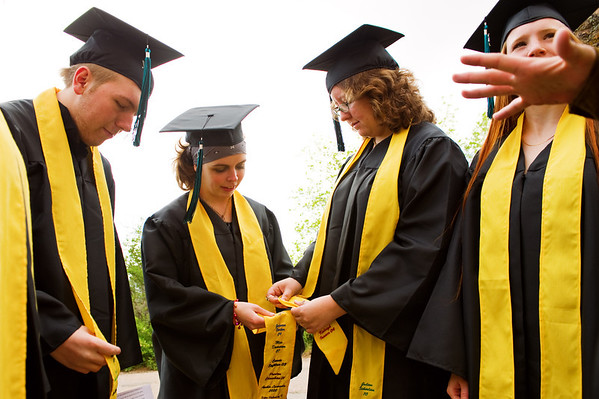 N0529NEWVISTA2.jpg N0529NEWVISTA2<br /> L-R: Cameron Amirfathi, Lorien Russell, Amber Mayfield, Rowan Turner and Grynn Reiff check their gowns before the start of the New Vista High School graduation ceremony held at Chautauqua auditorium on Saturday May 28th, 2011.<br /> <br /> Photo by: Jonathan Castner