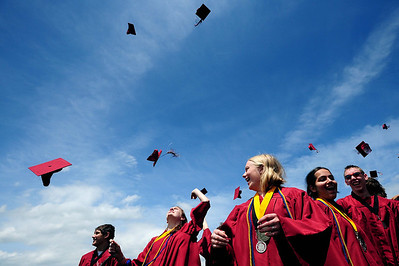20110528_SCHS_3.jpg McKenzie Gibson, third from left, and her fellow Silver Creek graduates toss their caps Saturday, May 28, 2011. (Joshua Buck/Times-Call)