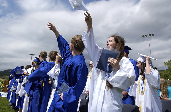 20110528_LYONS_GRAD_009.JPG Graduate Sarah Laurence tosses her cap with classmates during commencement at Lyons High School on Saturday, May 28, 2011. (Richard M. Hackett/Times-Call)