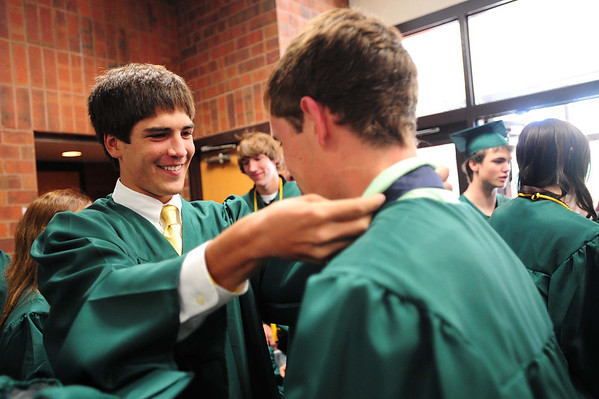 20110528_NHS_3.jpg Niwot graduate Cole Uhland helps out Adam Gang with his tie as they prepare for graduation on Saturday, May 28, 2011. (Joshua Buck/Times-Call)