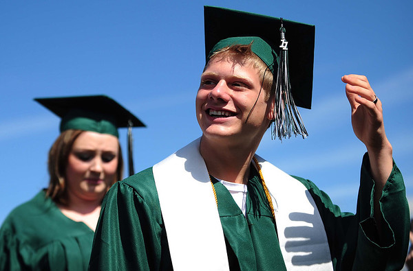 20110528_NHS_10.jpg A Niwot High School graduate waves to his friends and family while coming onto the field Saturday, May 28, 2011. (Joshua Buck/Times-Call)
