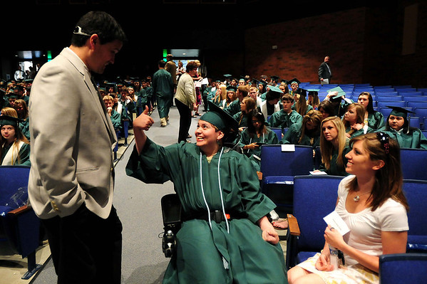 20110528_NHS_4.jpg Niwot assistant principal Jim Butterfield gets approval of his tie choice by graduate Nancy Chavez prior to their graduation Saturday, May 28, 2011. (Joshua Buck/Times-Call)