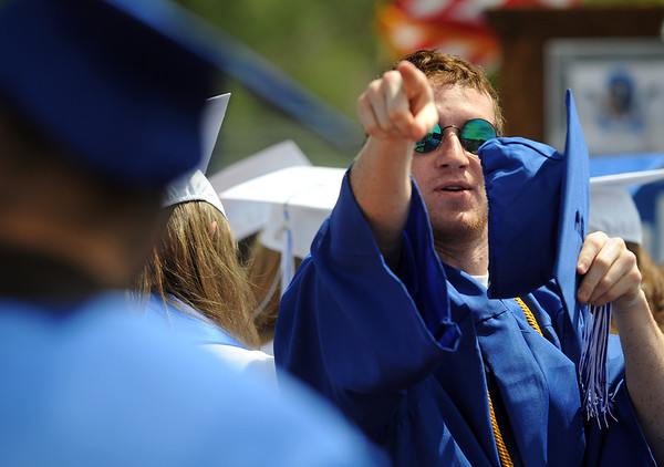 20110528_LHS_GRAD_6.jpg Graduate Joe Tulenko points to where he's going to throw his hat at the end of commencement Saturday May 28, 2011 at Longmont High School. (Lewis Geyer/Times-Call)
