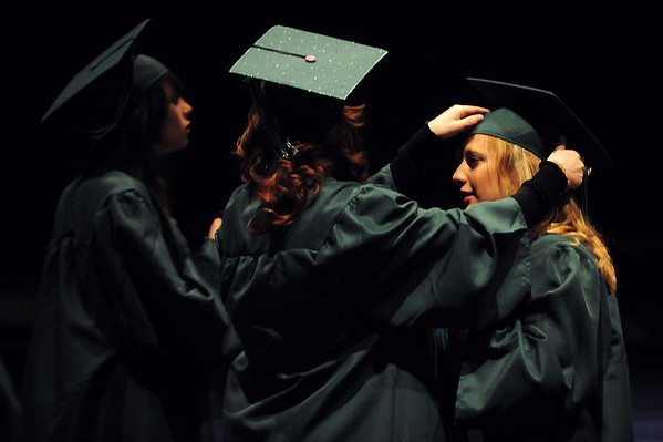 20110528_NHS_1.jpg Niwot graduate Rachel Rhodes, right, gets some help with her cap from Amanda Hobaugh before their graduation Saturday, May 28, 2011. (Joshua Buck/Times-Call)