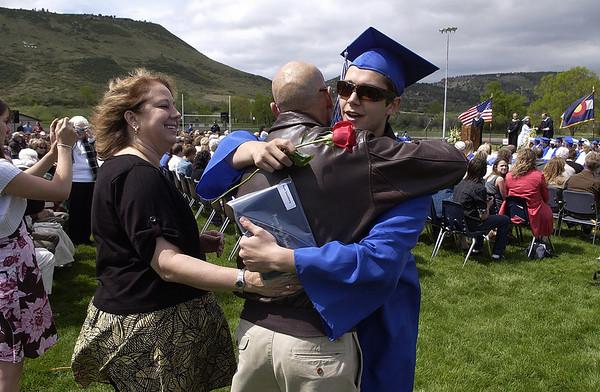 20110528_LYONS_GRAD_008.JPG Ryan Darenberg hugs his parents, Richard and Sally Darenberg, during commencement at Lyons High School on Saturday, May 28, 2011. (Richard M. Hackett/Times-Call)