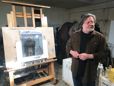 "NATHAN HAVENNER / GAZETTE Local artist John Jude Palencar is pictured in his studio with the 2019 Game of Thrones ""A Song of Ice and Fire"" Calendar cover image. Palencar has created over 300 book covers for artists including R.L. Stein, Stephen King and Christopher Paolini."
