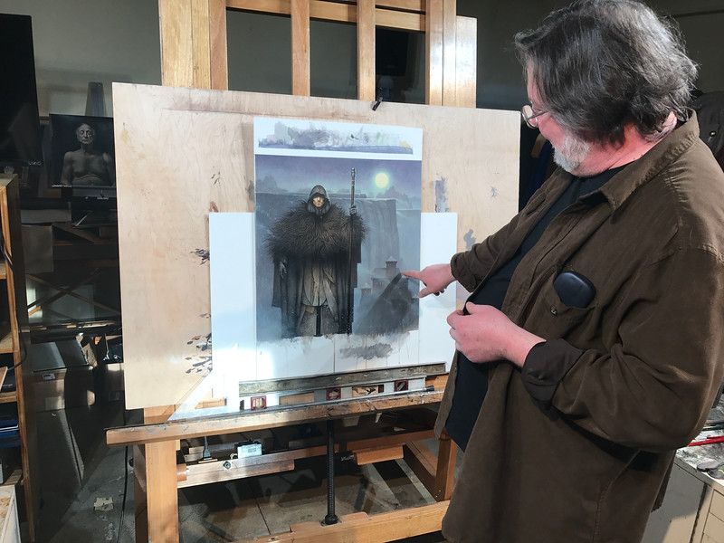 """NATHAN HAVENNER / GAZETTE Local artist John Jude Palencar is pictured in his studio with the 2019 Game of Thrones """"A Song of Ice and Fire"""" Calendar cover image. Palencar has created over 300 book covers for artists including R.L. Stein, Stephen King and Christopher Paolini."""