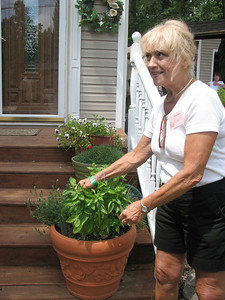 Chippewa Lake resident Jeanette Rhyner shows off her garden during the Medina County YWCA's annual Garden Tour on Sunday. (Jennifer Pignolet/Gazette)