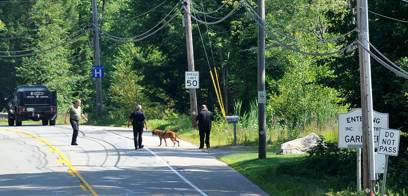 Gardner PD along with a bloodhound from the Worcester County Sherriff search along Rt 68 near the Hubbardston line for missing Asperger's patient. SENTINELANDENTERPRISE/ Jim Marabello