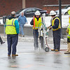 Pedestrians walk by as Unitil employees work at fixing a gas leak on Main St. in Fitchburg on Monday. Traffic was rerouted down Wallace Ave. off Main St.<br /> SENTINEL & ENTERPRISE / BRETT CRAWFORD