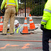 A Unitil employee is seen making his way down a manhole as a gas leak was being fixed on Main St. in Fitchburg, Monday. Traffic was rerouted down Wallace Ave.<br /> SENTINEL & ENTERPRISE / BRETT CRAWFORD