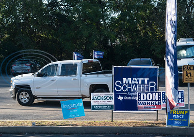 A truck donning Trump flags cruises the parking lot of the WorkHub voting center in Tyler on Tuesday, Nov. 3, 2020. Smith County citizens could vote at any of the 35 Smith County polling locations on Election Day.