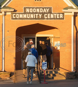 People walk inside as the doors open at 7 a.m. for voting at the Noonday Community Center on Tuesday, Nov. 3, 2020. Smith County citizens could vote at any of the 35 Smith County polling locations on Election Day.