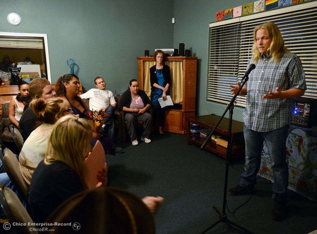 . Derek Kantack (right) shares his story to people who came out for the 6th Street Center for Youth open house, art show and poetry reading in recognition of Runaway and Homeless Youth Month Thursday, November 14, 2013 in Chico, Calif.  (Jason Halley/Chico Enterprise-Record)