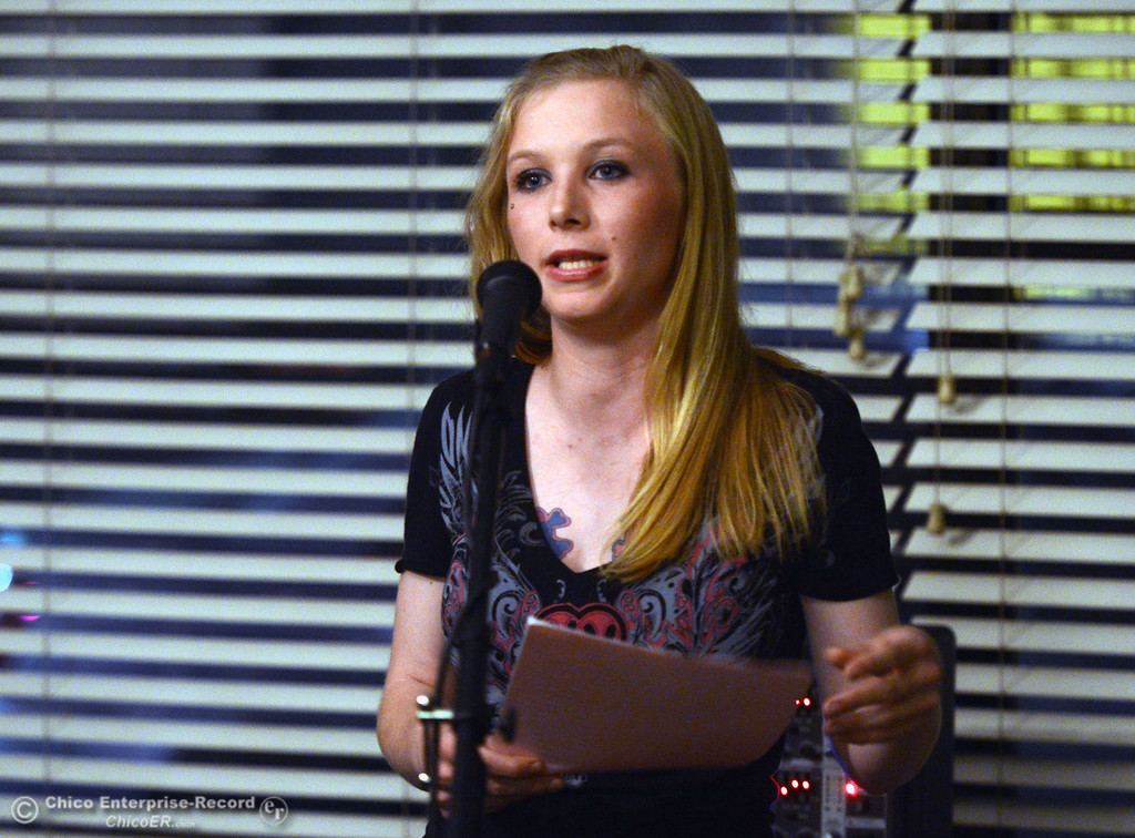 . Summer Nelson, 23, shares her story to people who came out for the 6th Street Center for Youth open house, art show and poetry reading in recognition of Runaway and Homeless Youth Month Thursday, November 14, 2013 in Chico, Calif.  (Jason Halley/Chico Enterprise-Record)