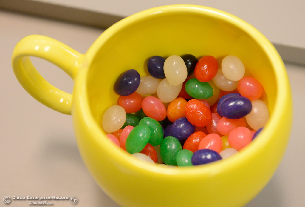. A large cup of jelly beans seems like a popular item in the Chico Police and Fire Dispatch Center located at the Chico Police Dept. in Chico, Calif. Wed. April 16, 2014. Being a dispatcher is a stressful job. They\'re the people who take all of the 911 calls, coordinate assistance to people who call, keep the officers safe and oversee how the Cico Police Department operates. (Bill Husa - Enterprise-Record)