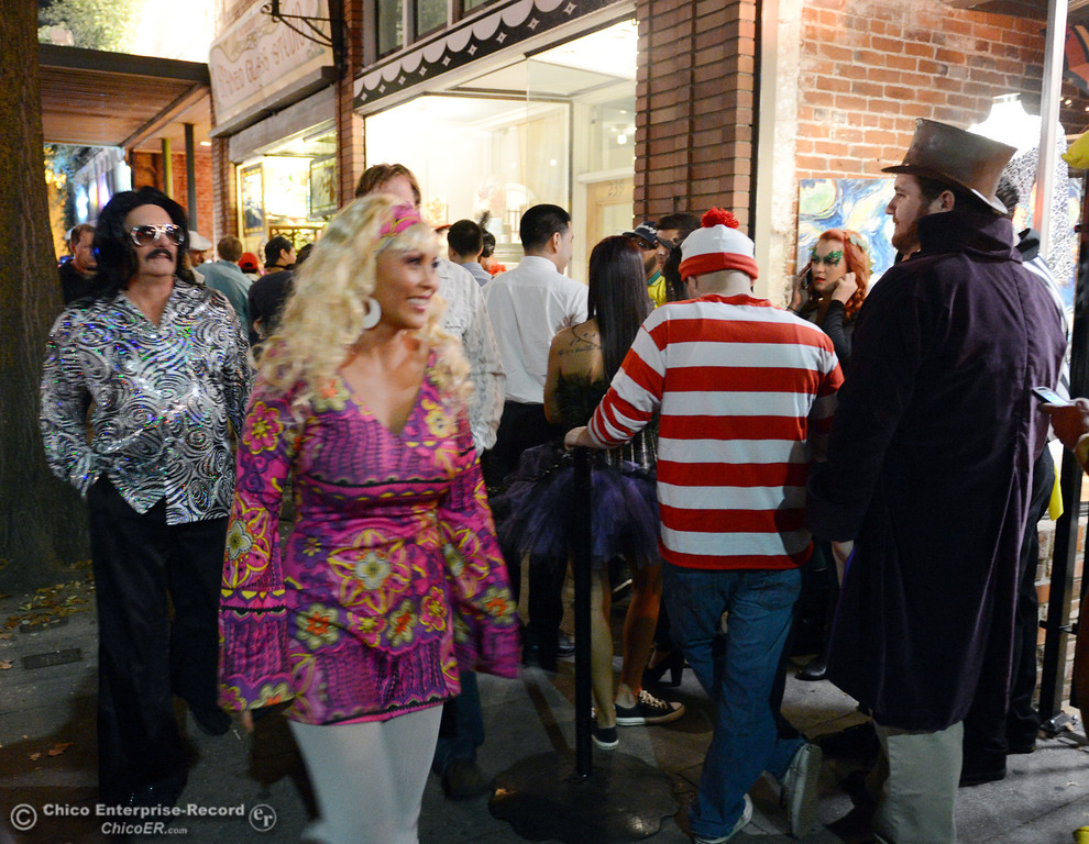 . Costumed crowds walk through the streets of downtown and south Chico State campus area for Halloween Thursday, October 31, 2013 in Chico, Calif.  (Jason Halley/Chico Enterprise-Record)