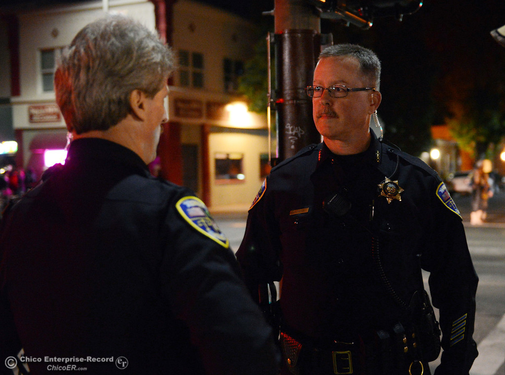 . Chico Police Sgt. George Laver (left) and Chief Kirk Trostle (right) patrol the through the streets of downtown and south Chico State campus area for Halloween Thursday, October 31, 2013 in Chico, Calif.  (Jason Halley/Chico Enterprise-Record)