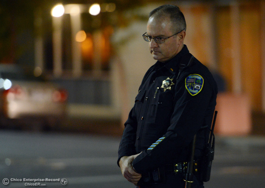 . Chico Police Lt. Mike O\'Brien patrols the through the streets of downtown and south Chico State campus area for Halloween Thursday, October 31, 2013 in Chico, Calif.  (Jason Halley/Chico Enterprise-Record)