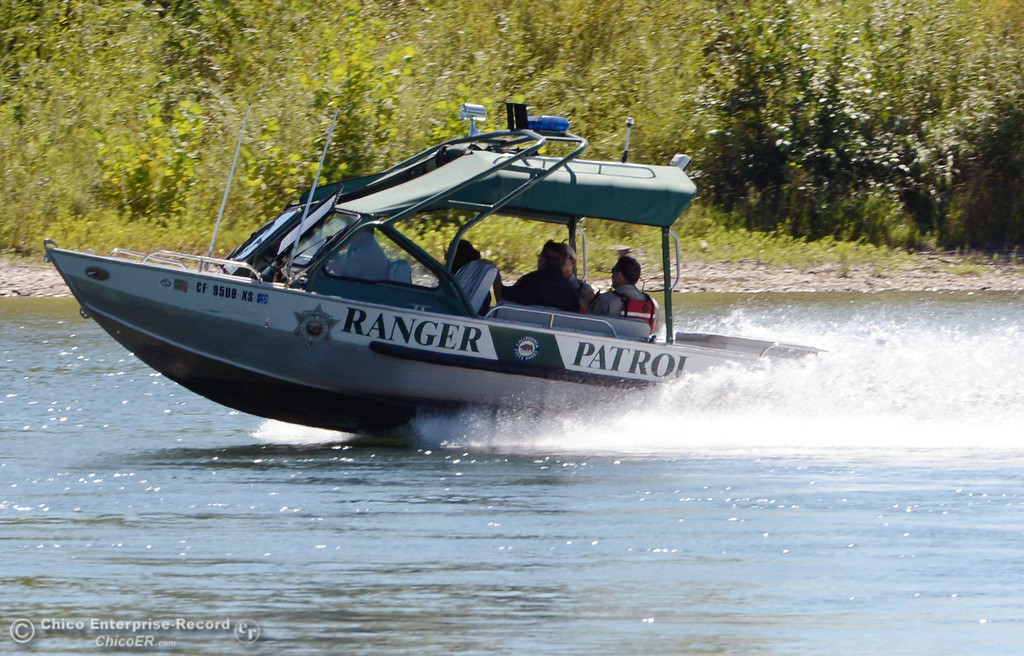 . A California State Parks patrol boat cruises the Sacramento River as there were very few people that came out to float on the river, which authorities were enforcing an alcohol ban as part of Labor Day weekend Saturday, August 31, 2013 in Hamilton City, Calif.  (Jason Halley/Chico Enterprise-Record)