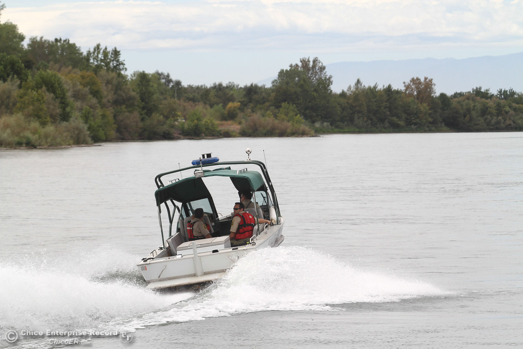 . Butte County Sheriff boat makes its way back up the Sacramento River  on Sunday, September 1, 2013 to patrol and keep floaters safe. (Frank Rebelo/Staff Photo)