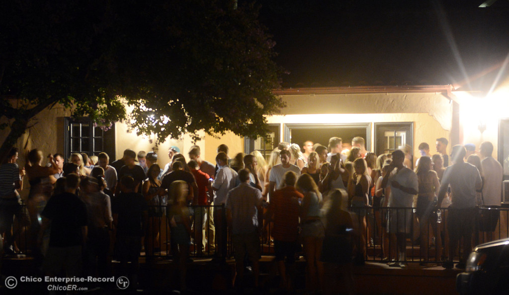 . People party at a house along 4th Street and Hazel Street as the south campus area was fairly quiet before Labor Day weekend starting Friday, August 30, 2013 in Chico, Calif.  (Jason Halley/Chico Enterprise-Record)