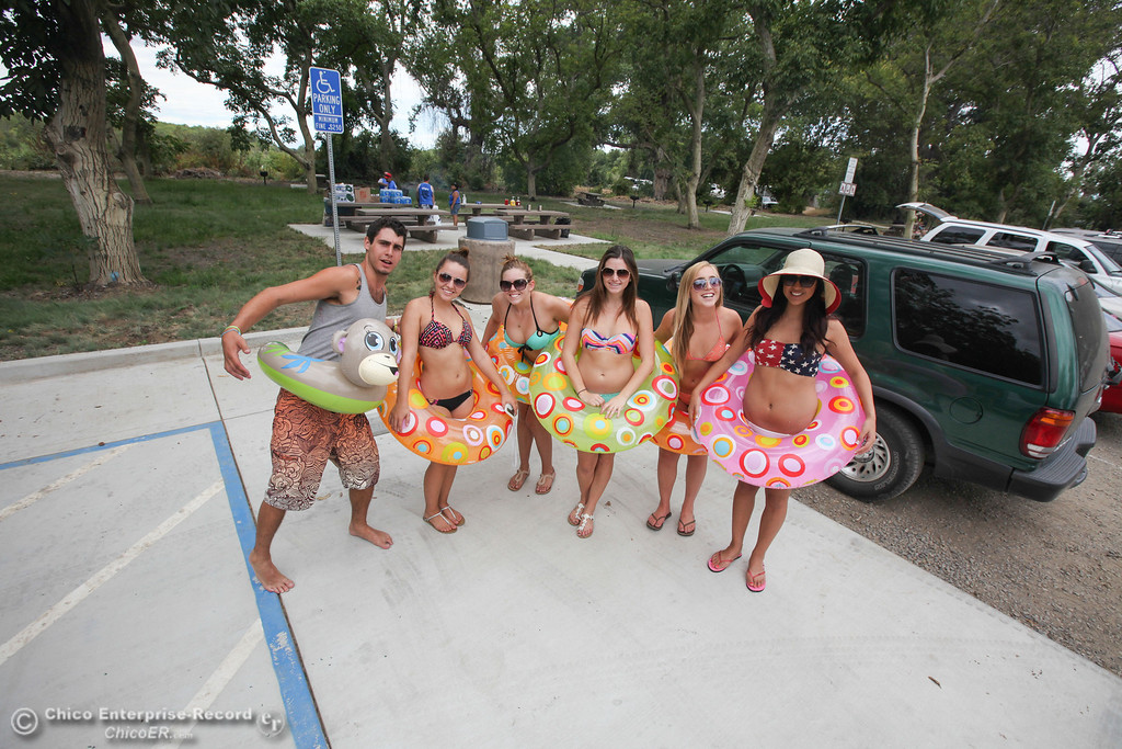 . A group of floaters pose for a photo before heading out on the Labor Day weekend float on the Sacramento River on Sunday, September 1, 2013. (Frank Rebelo/Staff Photo)