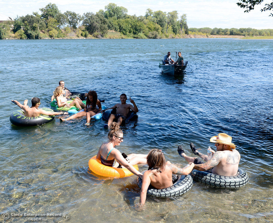 . A handfull of people who wanted to keep up the tradition of floating on the Sacramento River between the Irvine Finch boat Launch and Pine Creek near Scotty\'s Boat Landing launch their tubes Labor Day Monday, Sept. 2, 2013. (Bill Husa/Staff Photo)