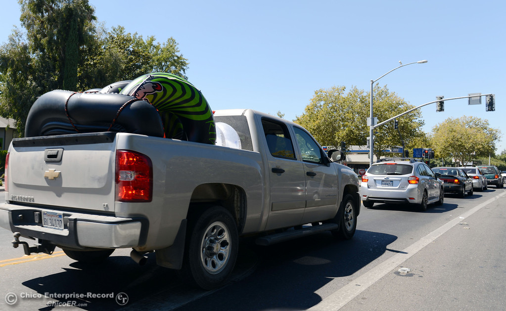 . There were very few people driving with tubes in their vehicles, like this truck along West Sacramento Ave that came out to float on the river that enforced an alcohol ban as part of Labor Day weekend Saturday, August 31, 2013 in Chico, Calif.  (Jason Halley/Chico Enterprise-Record)
