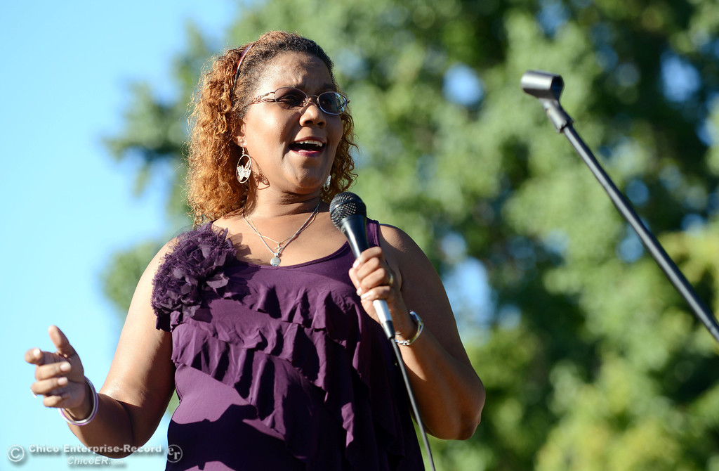 . Cara Lamumba sings the Black National Anthem to the community that came out to remember the 50th Anniversary of the Martin Luther King Jr. March on Washington by marching from the Dorothy Johnson Center to Community Park on Wednesday, August 28, 2013 in Chico, Calif.  (Jason Halley/Chico Enterprise-Record)