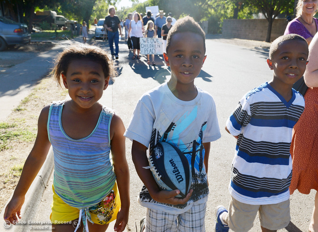 . Saprinah Fairbanks, 6, Savaun Fairbanks, 7, and Kivonte Fairbanks, 8 (left to right) march with the community came out to remember the 50th Anniversary of the Martin Luther King Jr. March on Washington by marching from the Dorothy Johnson Center to Community Park on Wednesday, August 28, 2013 in Chico, Calif.  (Jason Halley/Chico Enterprise-Record)