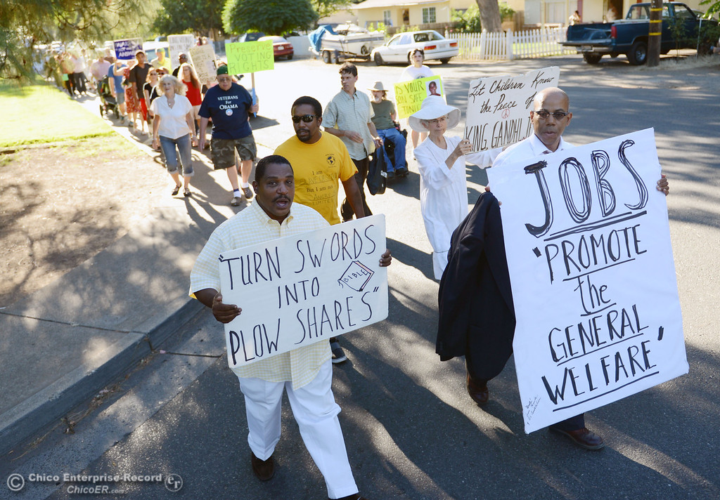 . Vince Haynie (left) and Gregory Cheadle (right) lead the community that came out to remember the 50th Anniversary of the Martin Luther King Jr. March on Washington by marching from the Dorothy Johnson Center to Community Park on Wednesday, August 28, 2013 in Chico, Calif.  (Jason Halley/Chico Enterprise-Record)