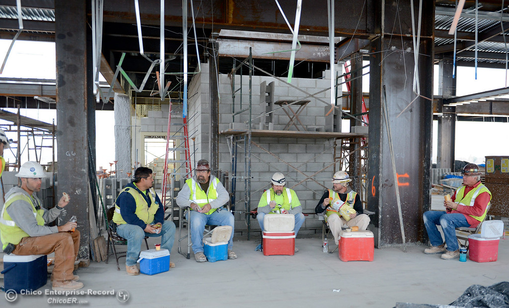 . Workers take a break during construction of the new North Butte County Courthouse located off of Bruce Road at 1701 Concord Ave. in Chico, Calif. Wednesday Jan. 29, 2014.  (Bill Husa/Staff Photo)