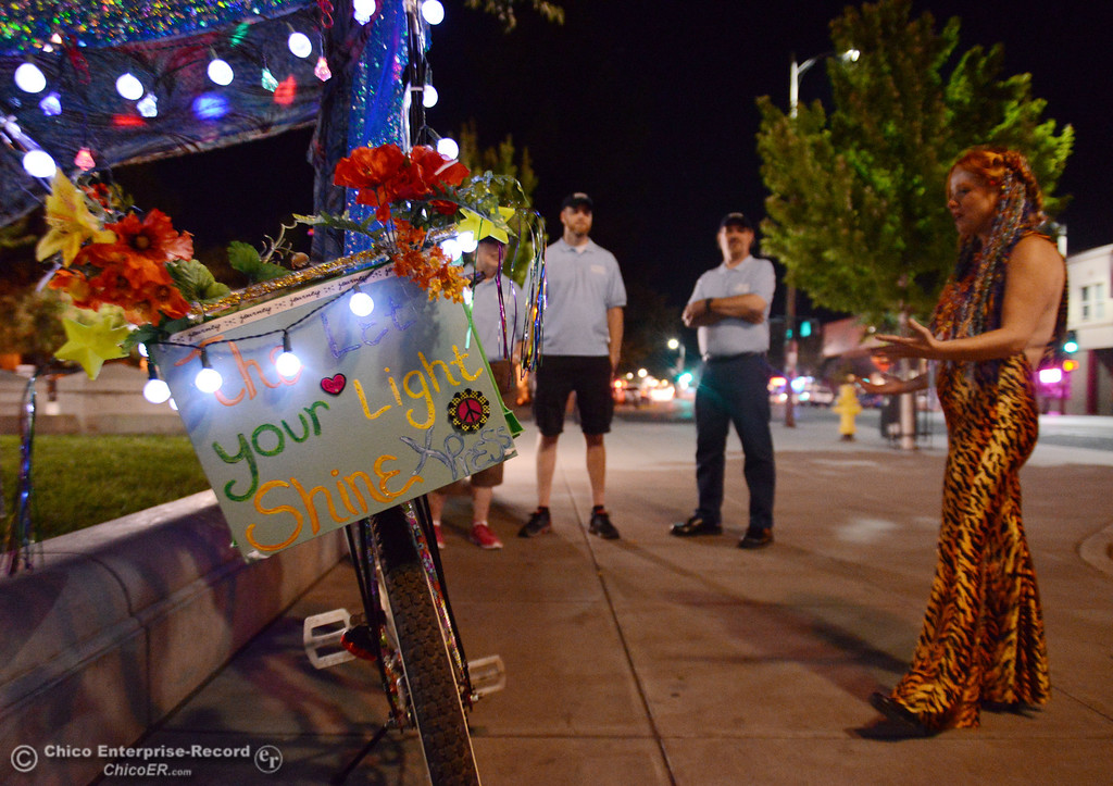 . Kelly Mosenfelder created a colorful light bike for burning man that she test rode around downtown as she talks with people that were part of the Street Pastors program Friday, August 23, 2013 in Chico, Calif.  (Jason Halley/Chico Enterprise-Record)