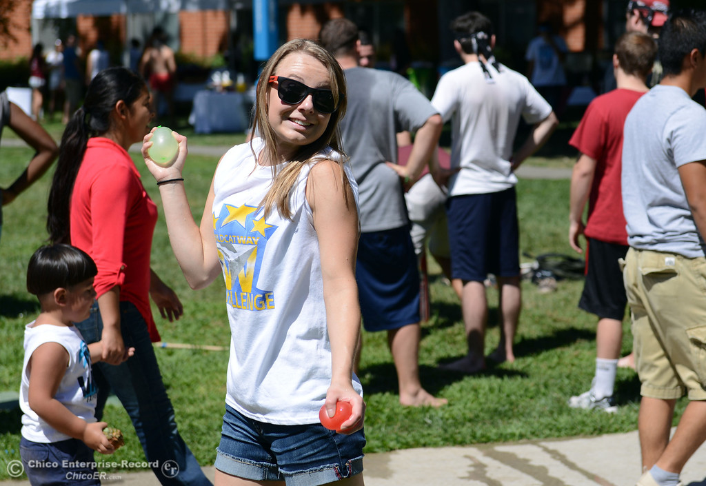 . Chico State student Michaela Leonard, 19 gets ready to throw a water balloon as they play games as alternative activities to floating on the Sacramento River for Labor Day at the Wildcat Challenge event on the lawn between Lassen Hall and Sutter Hall on the Chico State Campus Saturday, August 31, 2013 in Chico, Calif.  (Jason Halley/Chico Enterprise-Record)