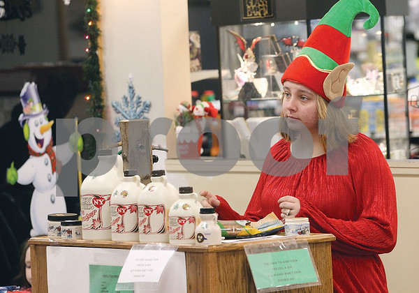 Spencer Tulis/Finger Lakes Times Malaya Malchoff, an employee at the Petro Waterloo Travel Centers of America mans a stand selling New York State maple syrup products during a recent craft and gift event that was held there.