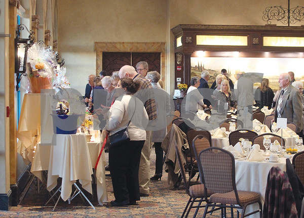 Spencer Tulis/Finger Lakes Times The Pathway Home Fall Gala was held recently at Ventosa Vineyards as guests are pictured looking over some of the basket raffle items on display.