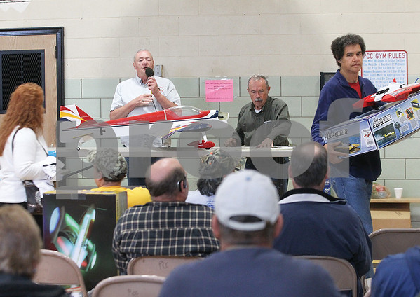 Spencer Tulis/Finger Lakes Times An auction of remote control planes and other items took place Saturday at the Phelps Community Center. Auctioneer at the event was Dave Breed (holding microphone) of Phelps.