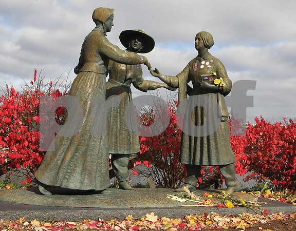 """Spencer Tulis/Finger Lakes Times """"I Voted"""" stickers along with some now wilting flowers are pictured in the brionze statue of Elizabeth Cady Stanton, Amelia Bloomer and Susan B. Anthony that stands in Seneca Falls- also known as the """"Birthplace of Women's Rights"""" after many hoped the election would provide an historic outcome signalling the progress of women in this country."""