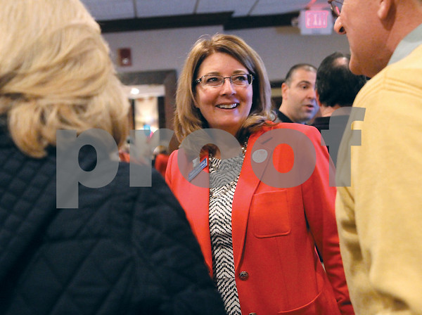 Spencer Tulis/Finger Lakes Times Pam Helming talks with supporters at the Inn at Canandaigua Tuesday evening as results started to come in.