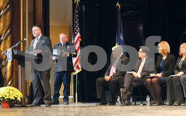 Spencer Tulis/Finger Lakes Times A Finger Lakes Salute to honor outgoing state Sen. Mike Nozzolio at The Smith Center for the Arts Wednesday featuring a long list of individuals and organizations who offered kind words of praise. Oictured at the podium is Geneva City Manager Matt Horn  while Geneva Police Chief Jeff Trickler waits for his opportunity to speak.