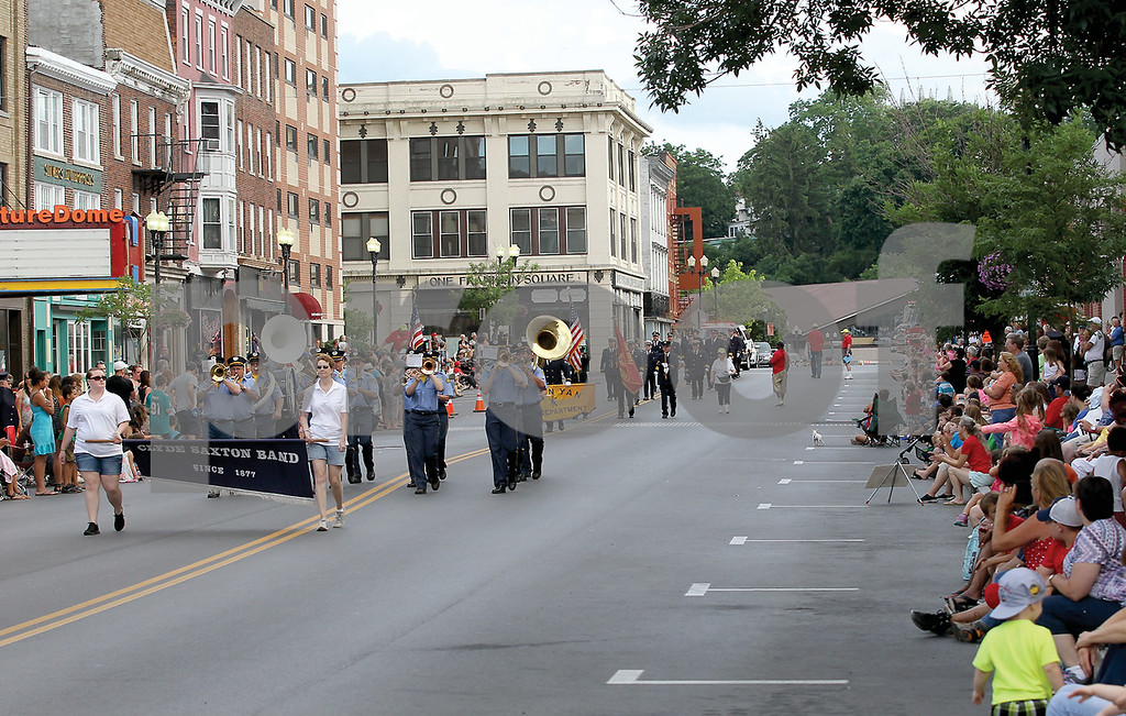 Spencer Tulis/Finger Lakes Times<br /> Large crowds came out for a pleasant evening Saturday to watch the annual Geneva Fireman's Parade through the streets of the city's downtown.