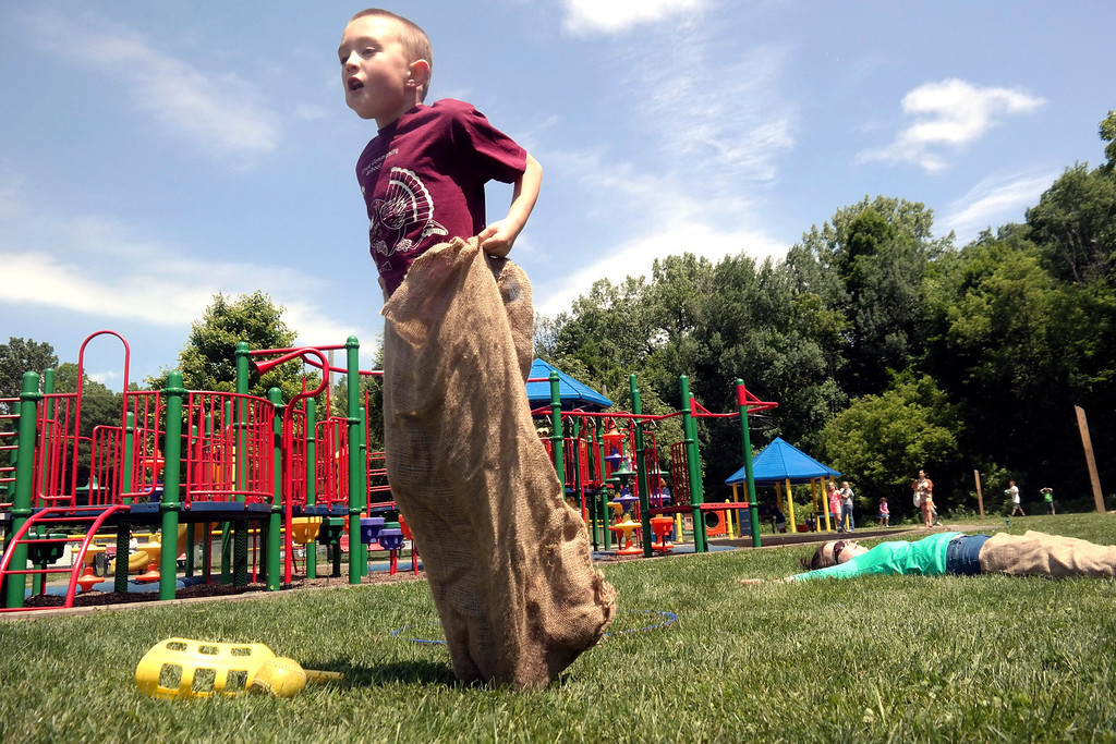 . Alex Fallon, age 8, leaves his competition in the dust in a sack race at Springside Park in Pittsfield for National Get Outdoors Day, Saturday June 14, 2014.  Ben Garver / Berkshire Eagle Staff / photos.berkshireeagle.com